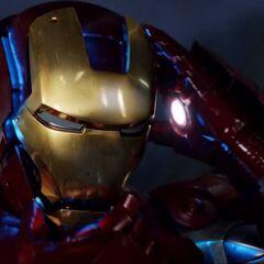 Iron Man puts on his helmet.