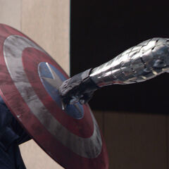 Bucky's metal arm colliding with Cap's shield in <i>The Winter Soldier</i>