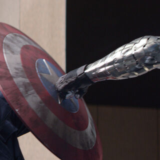 Bucky's metal arm colliding with Cap's shield