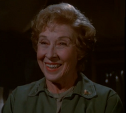 Carmen Matthews as Col. Lil Rayburn