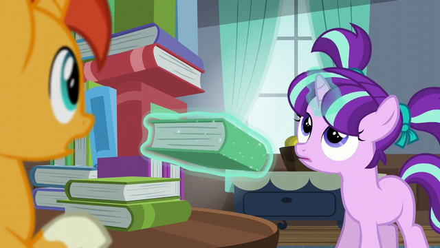 File:Filly Starlight levitates book out; looks up at book tower S5E26.png