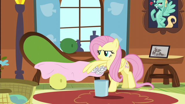 File:Fluttershy cleaning up Zephyr's mess S6E11.png