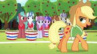 Applejack addressing the unicorns S6E18
