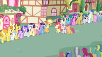Crowd staring at CMC S03E04