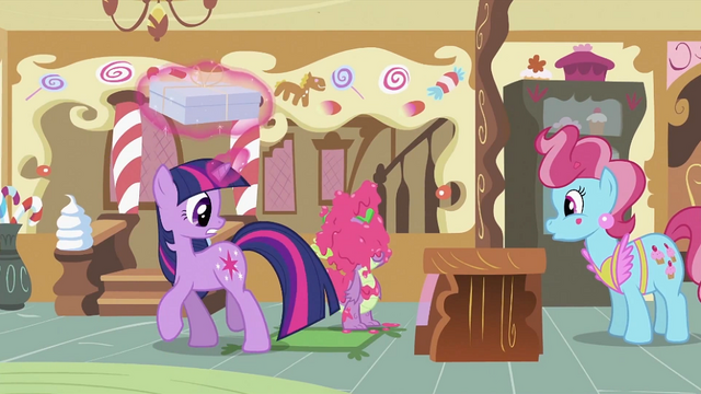 File:Twilight looking at Spike covered in icing S2E03.png