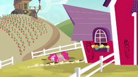 Pinkie Pie walking alongside scroll S4E09