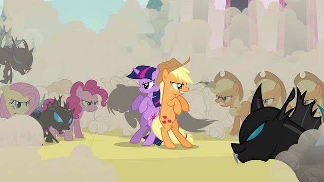 File:Applejack and changeling Twilight together S2E26.png