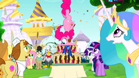 Pinkie Pie taking a huge bite S2E24