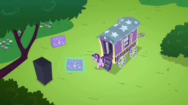 File:Starlight unpacking Trixie's wagon S6E6.png