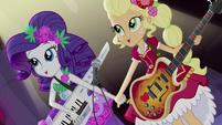 Rarity and Applejack singing hand-in-hand EG4