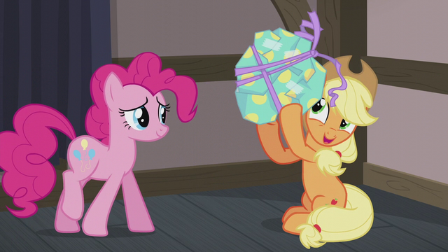 File:Applejack shaking Pinkie's present S5E20.png