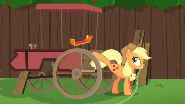 File:Applejack kicks spoiler off of the cart S6E14.png