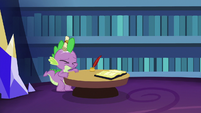 Spike hit on the head with a scroll S6E15