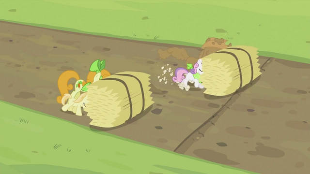 File:Rarity and Sweetie Belle pushing hay bale S2E05.png