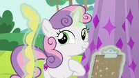 Sweetie Belle levitating a yellow fringe S6E14