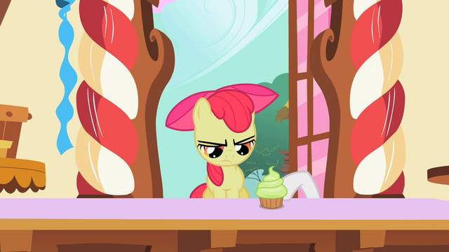 File:Sweetie Belle pushing cupcake to Apple Bloom S2E06.png