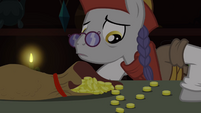 Mercant looking at Trixie's offered Bits S3E5