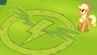 Wonderbolts insignia in the grass S4E21