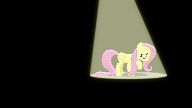 File:Fluttershy sings under a spotlight S6E11.png