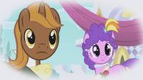 Chocolate Tail and Purple Wave looking at Rarity S1E03