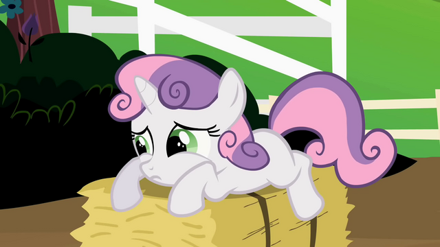 File:Sweetie Belle looking sad on a hay bale S2E5.png