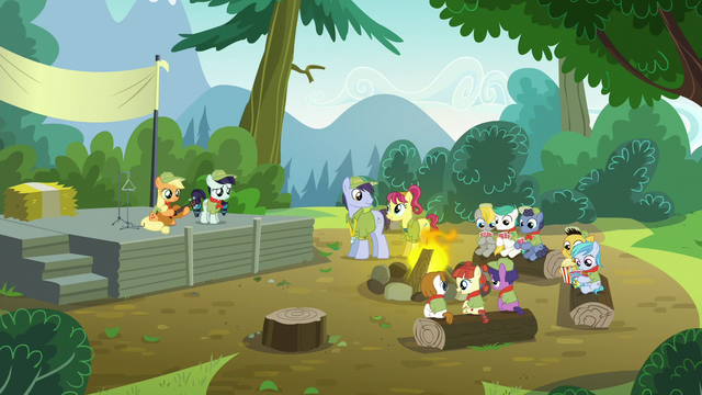 File:Applejack and Rara on stage; AJ holds a guitar S5E24.png