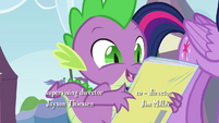 Spike holding mint Power Ponies comic S4E22