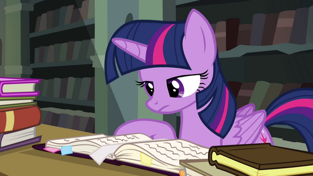 File:Twilight reading through the journal S4E25.png