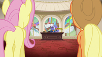 Fluttershy and Applejack enter Gladmane's office S6E20