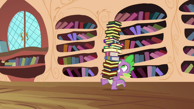 File:Spike carrying a tower of books S03E10.png