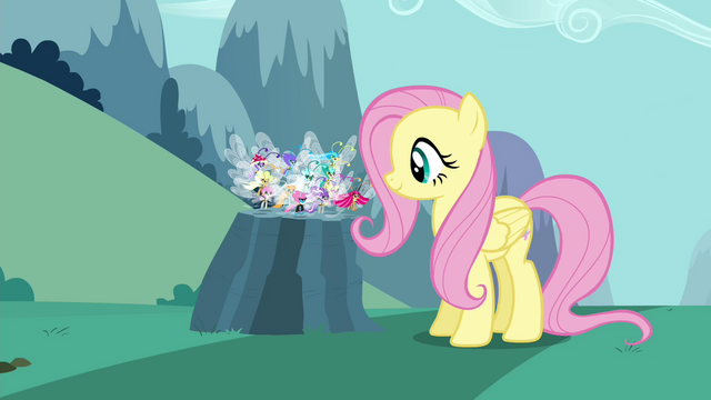 File:Fluttershy setting the Breezies down S4E16.png