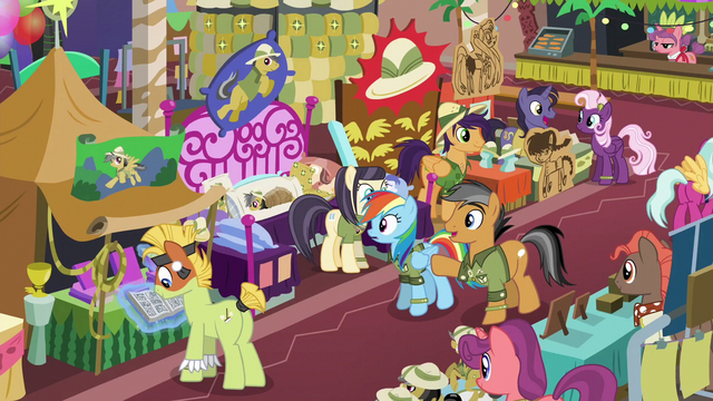 File:Quibble pointing at a convention booth S6E13.png