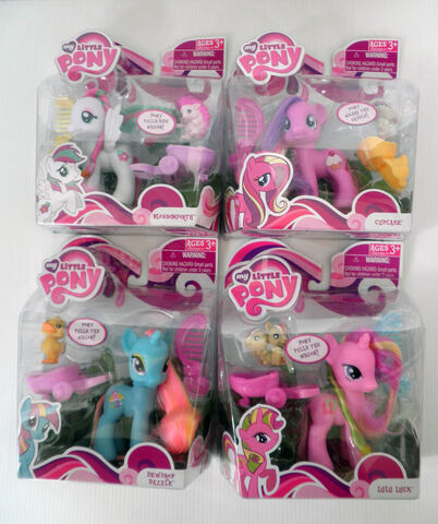 File:Blossomforth, Cupcake, Dewdrop Dazzle and Lulu Luck toys.jpg