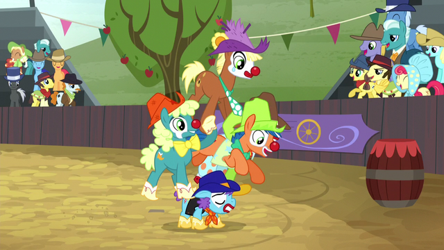 File:Clown jumps through ring of other rodeo clowns S5E6.png