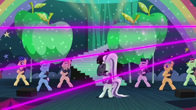 File:Coloratura and backup dancers putting hooves on their chest S5E24.png