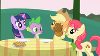 Apple Bumpkin drops candy apples on the table S1E01