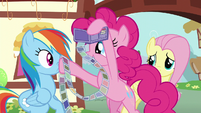 Pinkie shoving photos in Rainbow's face S6E11