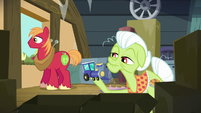 Granny Smith holds a piece of a toy train S5E17