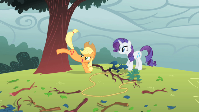File:Applejack bucking a tree S1E08.png