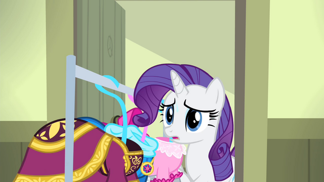 File:Rarity bringing in the dresses S4E19.png