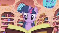 Twilight skimming through a book S01E05