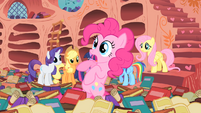 Pinkie Pie teetering in book sea S1E16