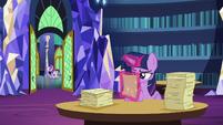 Starlight trots past the library door S6E1
