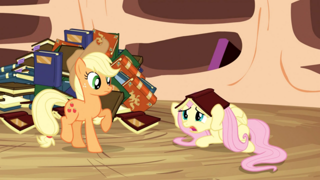 File:Fluttershy hides under book S3E05.png