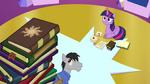 Book with Celestia's cutie mark on top of book pile EG2