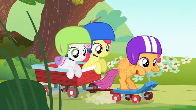 File:Scootaloo on her scooter pulling Apple Bloom and Sweetie Belle on a wagon S1E23.png