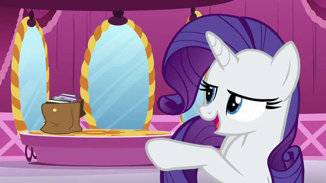 File:Rarity points at a bag filled with books S5E22.png