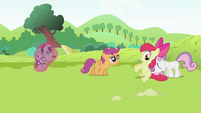 Sweetie Belle pushing Apple Bloom S2E03