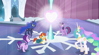 Starlight, Twilight, Luna, Celestia, and Sunburst look at the glowing Crystal Heart S6E2