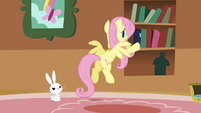 Fluttershy putting the books back into the bookshelf S3E10